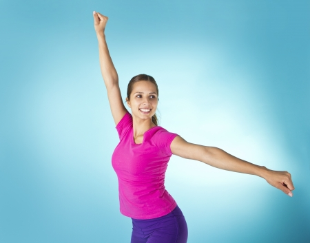 arms raised: Beautiful Woman Aerobic Workout Stock Photo