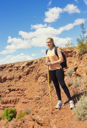 Woman Hiking in the Rugged Desert Mountains photo
