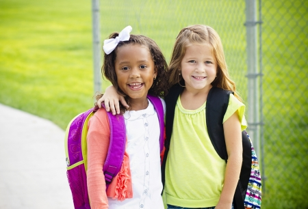 leaving: Two little kids going to school together Stock Photo