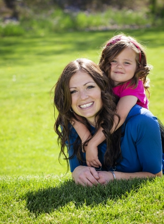 Smiling Happy Mother and daughter playing outdoors together Stock Photo