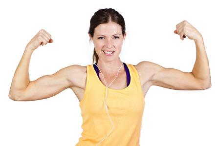 Fuertes hermosos bíceps Mujer que dobla Foto de archivo - 22252063