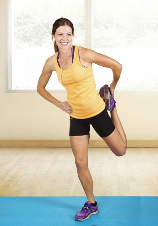 Fit muscular woman stretching before her workout  Indoor fitness class Stock Photo - 22252066