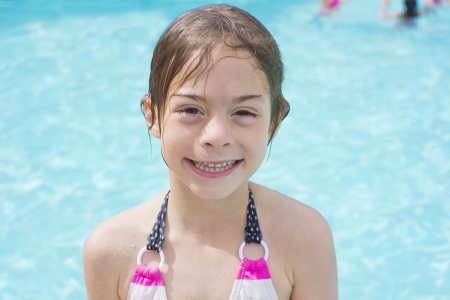 Cute little swimmer girl just getting out of the swimming pool Stock Photo - 22252068