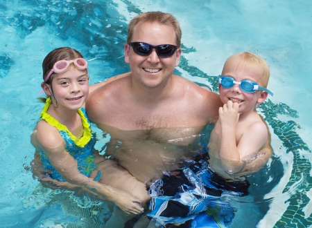 Family playing in the swimming pool together Stock Photo - 22252069