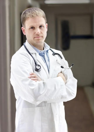 serious doctor: Young Male Doctor at a hospital