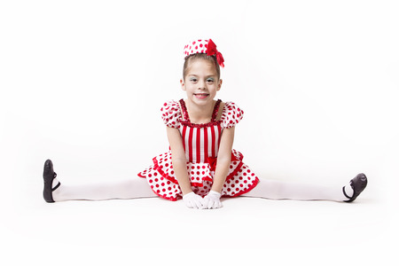 Cute little dancer girl isolated on white photo
