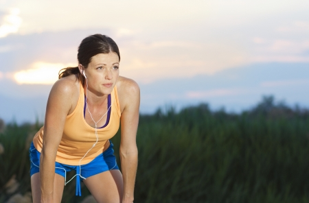 daily: Female Runner finishing a run Stock Photo