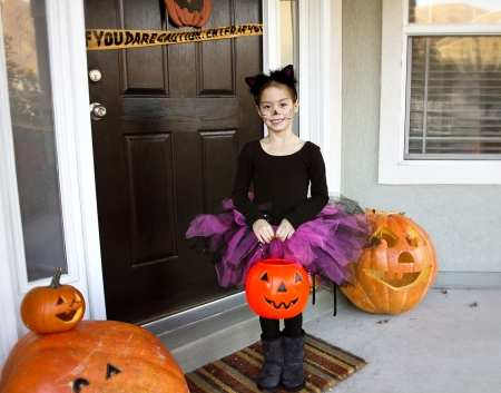 Little girl Trick-or-treating on Halloween photo