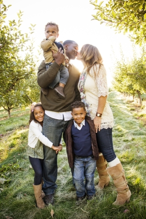 family photo: Beautiful Multi Ethnic Family Portrait Outdoors
