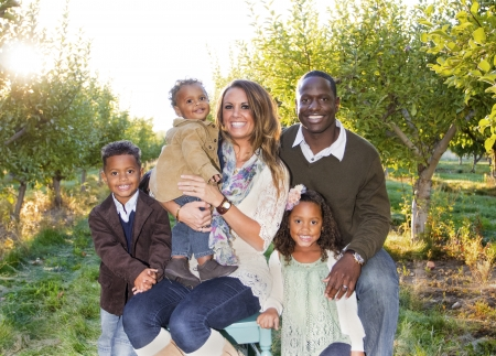 Multi Ethnic Family Portrait Outdoors