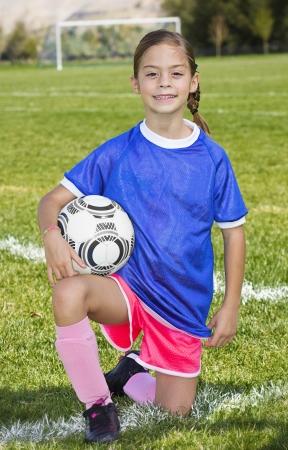 Cute little Soccer player portrait  girl  photo