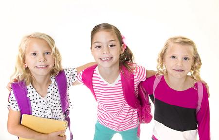 cute little girls: Grupo de lindas ni�as ir a la escuela Foto de archivo