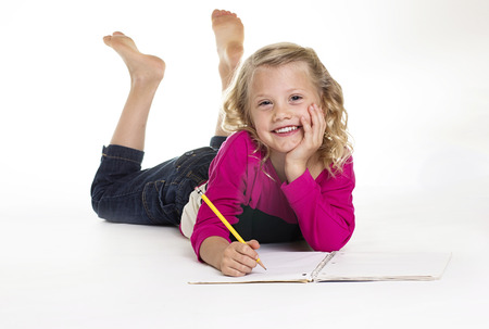little girl barefoot: Cute little Girl Doing her homework