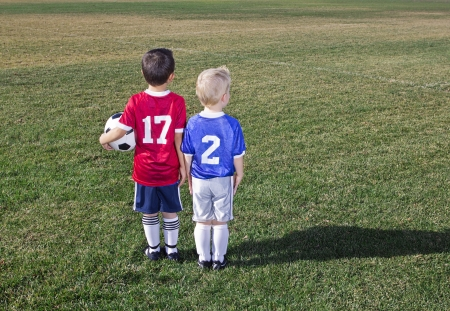 youth football: Two Young Soccer Players on the field Stock Photo