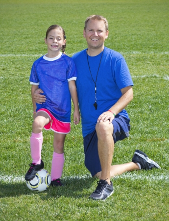 soccer cleats: Soccer Coach and Young Soccer Player portrait