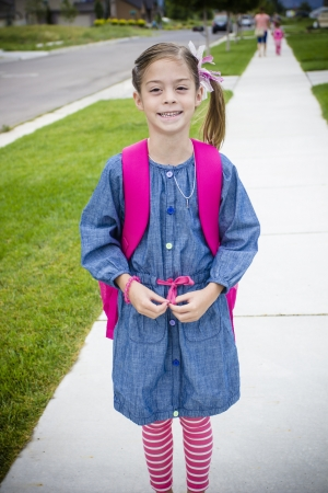 Cute Little Girl Walking to School photo
