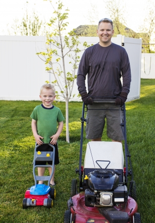 examples: Father and Young Son mowing the lawn together