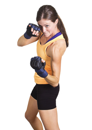 tough girl: Fit and muscular woman boxing