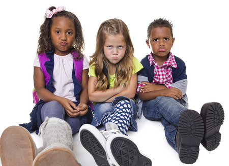 Group of unhappy and upset school kids Stock Photo - 25114790