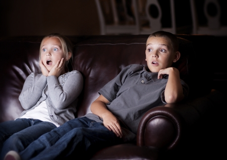 Children watching Shocking Television Programming Stock Photo - 25114795
