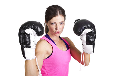 spunky: Fit woman wearing boxing gloves isolated