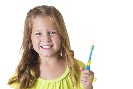 Cute Little Girl Brushing her teeth isolated on white Stock Photo