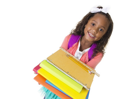 first day of school: Cute Diverse little student carry school books Stock Photo