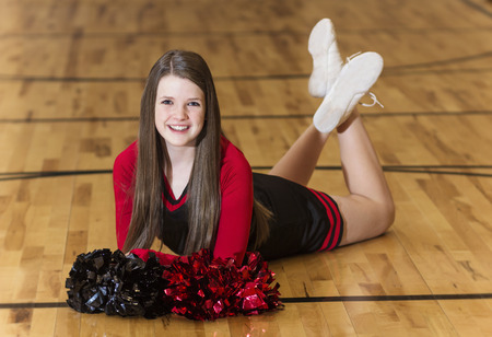 school activities: Young Teen Cheerleader Portrait
