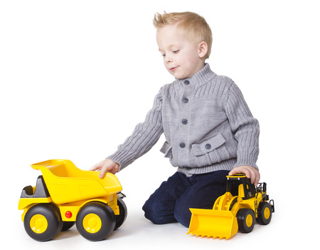 toy truck: Cute Boy playing with toy trucks