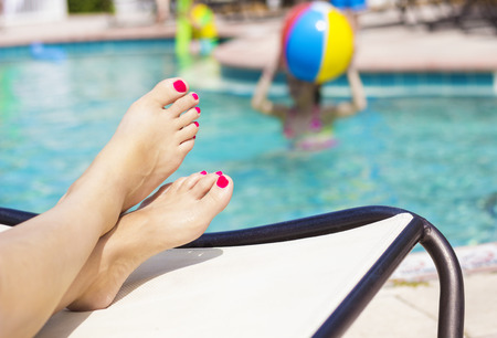 Beautiful Feet and toes by the swimming pool photo