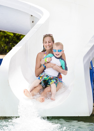 Family fun on the water slide at a waterpark photo