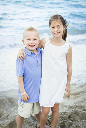 Smiling Children portrait at the beach photo