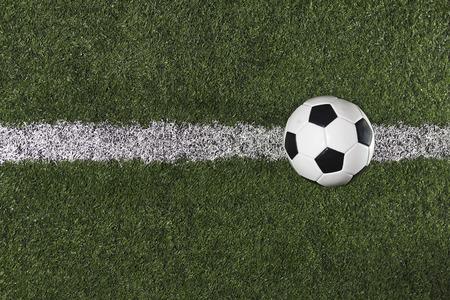 futbol soccer: Soccer Ball on the midfield on a Soccer Field Stock Photo