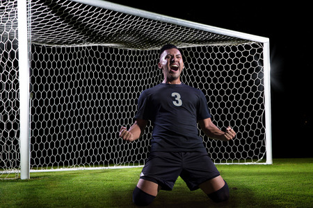 futbol: Hispanic Soccer Player celebrating a goal Stock Photo
