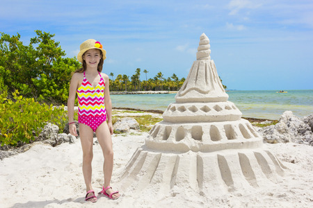 Building Giant Sandcastle on a tropical beach photo