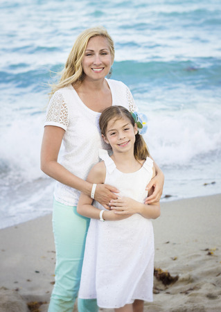 Mother and Daughter Portrait on Beach photo