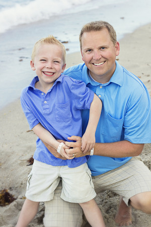 Father and Son Portrait on Beach photo