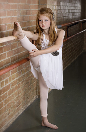 Talented Young Dancer Stretching photo