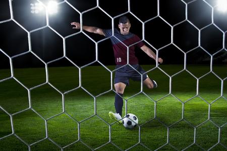 futbol soccer: Hispanic Soccer Payer scoring during a game