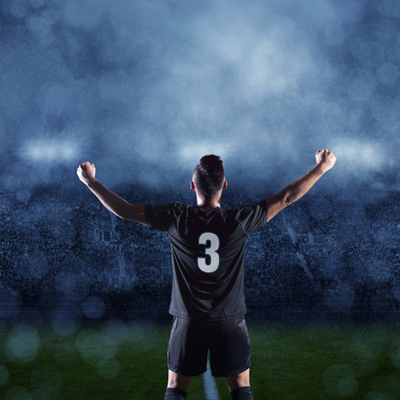 futbol: Hispanic Soccer Player Celebrating winning the game Stock Photo