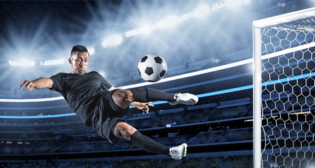 scoring: Hispanic Soccer Player kicking the ball
