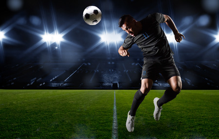 in action: Hispanic Soccer Player heading the ball Stock Photo