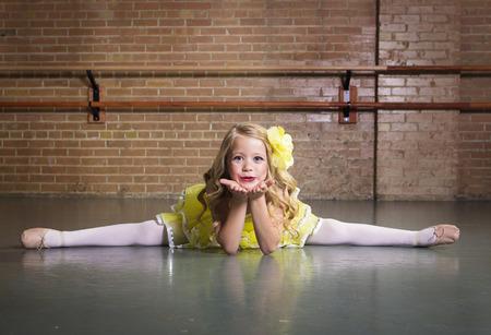 dancer legs: Beautiful little dancer portrait at a dance studio Stock Photo