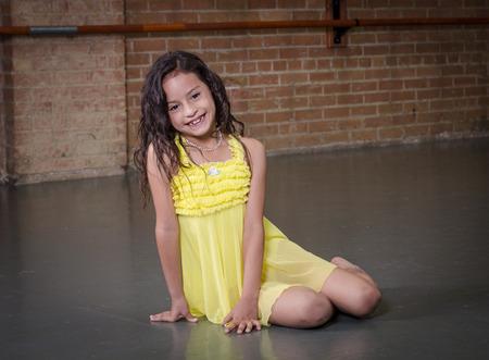 skirts: Cute young hispanic dancer in a dance studio