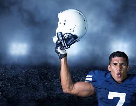 American Football Player celebrating a big win Stock Photo