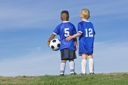 two: Youth Soccer Players standing together Rear View