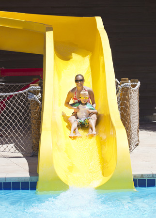 going down: Fun on the water slide at waterpark
