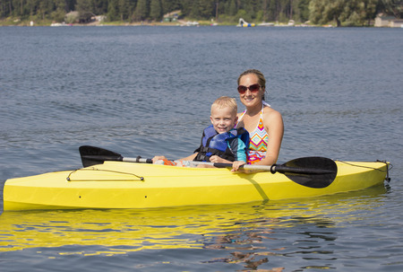 Family Kayaking together on a beautiful lake