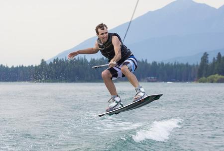 wakeboarding: Man wakeboarding on a beautiful mountain lake