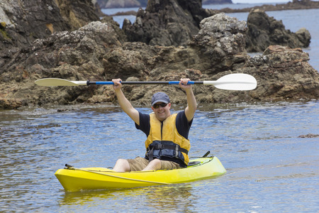 recreate: Man enjoying an ocean kayaking trip Stock Photo
